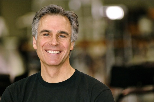 Mature man smiling with grey hair